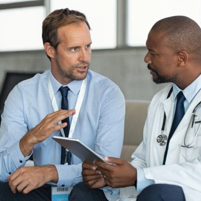 Showing two doctors consulting